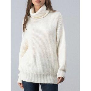 Soft knit turtleneck ivory tunic sweater